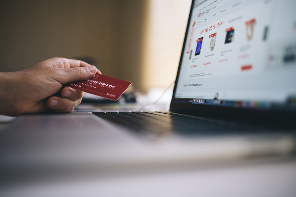 person online shopping instead of saving money for travel