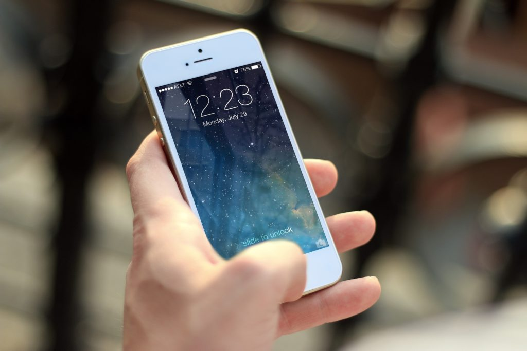 hand holding smartphone while traveling internationally