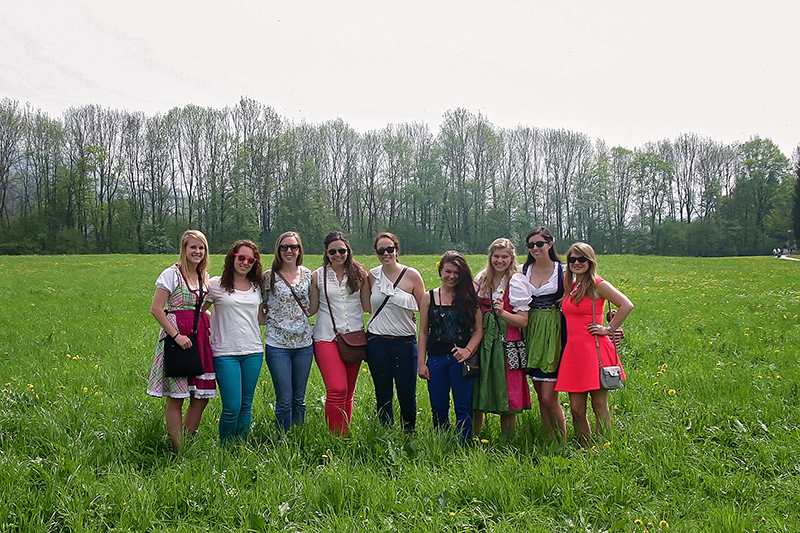 girls with study abroad friendships standing in field