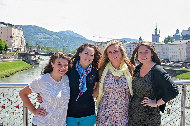 girls with study abroad friendships standing on bridge